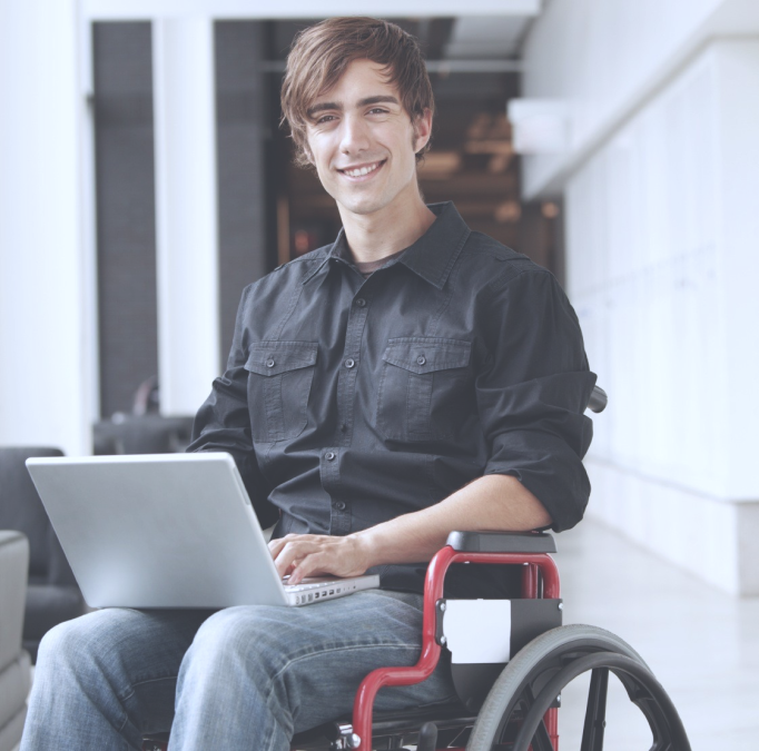 "<img src=""A-young-businessman-on-wheel-chair-with-a-laptop-smiling.jpg"" alt text= ""A young businessman on wheel-chair with a laptop smiling"" />"